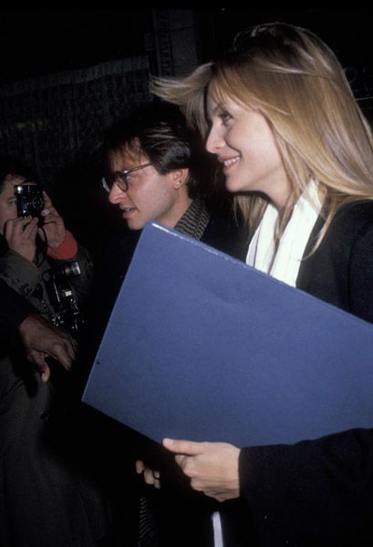 Title: fisher stevens and michelle pfeiffer photo1. Description: