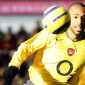 Henry to stay with Arsenal