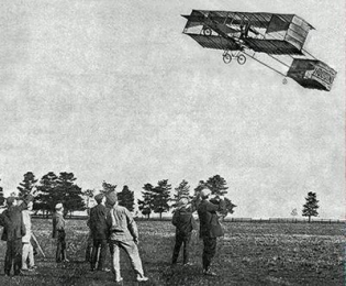 Who made the first powered flight?