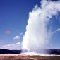 Why do geysers spout hot water?
